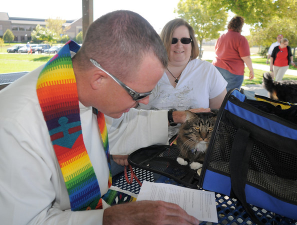 Pastor Scott R. McAnally of Lutheran Church of Hope blesses Harry owned by Lynn Vaneperen during the blessing of the animals at Community Park on Saturday.<br /> October 1, 2011<br /> staff photo/ David R. Jennings