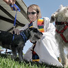 Vicar Kim Seidman of Holy Comforter Episcopal Church blessesSadie, left, and Gracie owned by Nancey Bookstein during the blessing of the animals at Community Park on Saturday.<br /> October 1, 2011<br /> staff photo/ David R. Jennings