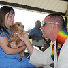 Pastor Scott R. McAnally of Lutheran Church of Hope blesses Princess held by owner Katelyn Rajewich, 7,  during the blessing of the animals at Community Park on Saturday.<br /> October 1, 2011<br /> staff photo/ David R. Jennings