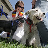 Vicar Kim Seidman of Holy Comforter Episcopal Church blesses Sadie, left, and Gracie owned by Nancey Bookstein during the blessing of the animals at Community Park on Saturday.<br /> October 1, 2011<br /> staff photo/ David R. Jennings