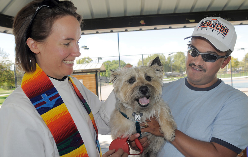 Vicar Kim Seidman of Holy Comforter Episcopal Church blesses Toto owned by Charlie Villarreal during the blessing of the animals at Community Park on Saturday.<br /> October 1, 2011<br /> staff photo/ David R. Jennings