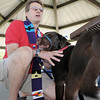 Pastor Thomas Cross of the Broomfield United Methodist Church blesses Brownie owned by Kyle Winchell, 12, during the blessing of the animals at Community Park on Saturday.<br /> October 1, 2011<br /> staff photo/ David R. Jennings