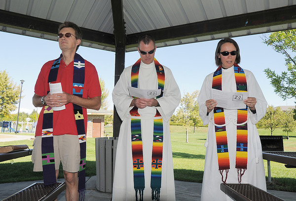 The Reverends Thomas Cross, left, Scott McAnally and Kim Seidman conduct the service for the blessing of the animals at Community Park on Saturday.<br /> October 1, 2011<br /> staff photo/ David R. Jennings
