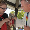 Pastor Scott R. McAnally of Lutheran Church of Hope blesses Miles owned by Monique Cichello during the blessing of the animals at Community Park on Saturday.<br /> October 1, 2011<br /> staff photo/ David R. Jennings