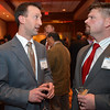 Joel Beyer, left, chats with Joshua Dutton during the Broomfield Chamber of Commerce's annual dinner at the Renaissance Hotel on Thursday featuring The Broomfield Apprentice.<br /> <br /> January 31, 2013<br /> staff photo/ David R. Jennings
