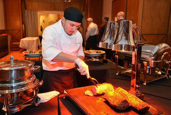 Chef Carlos Contreras prepares beef for the evening's dinner during the Broomfield Chamber of Commerce's annual dinner at the Renaissance Hotel on Thursday featuring The Broomfield Apprentice.<br /> <br /> January 31, 2013<br /> staff photo/ David R. Jennings
