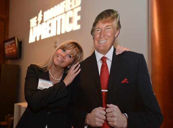 Jennifer Kerr poses with a cardboard cutout of Donald Trump during the Broomfield Chamber of Commerce's annual dinner at the Renaissance Hotel on Thursday featuring The Broomfield Apprentice.<br /> <br /> January 31, 2013<br /> staff photo/ David R. Jennings