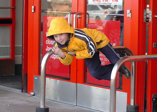 Sam Coldren, 7, plays at the doors of the Broomfield Target on the last day of the store on Saturday.<br /> January 26, 2012<br /> staff photo/ David R. Jennings