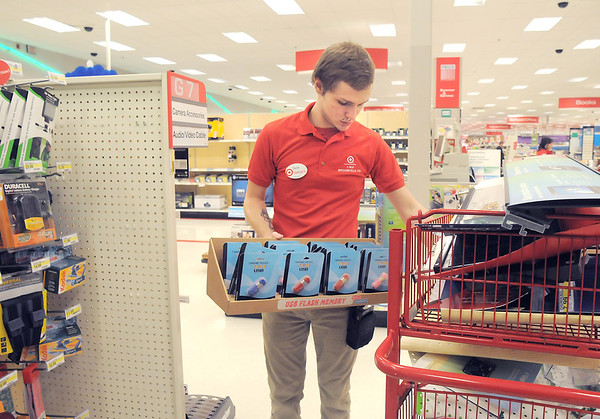 Target electronics team member Devin Johnson dismantles a display on the last day of the Broomfield Target store, Saturday.<br /> January 26, 2012<br /> staff photo/ David R. Jennings