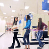 Hanna Grunwald, 14, left, Sydney Smith, 13 and Stephanie Reynolds, 14, wander the Broomfield Target store linked by hula hoops while shopping on the last day of the store on Saturday.<br /> January 26, 2012<br /> staff photo/ David R. Jennings