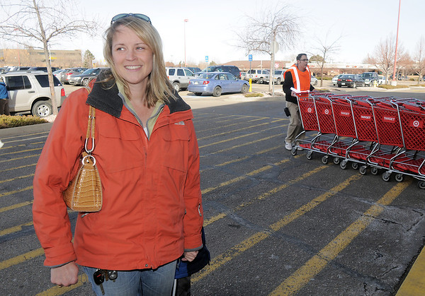 Anne Coldren walks to the Broomfield Target to shop on the closing day of the store on Saturday.<br /> January 26, 2012<br /> staff photo/ David R. Jennings