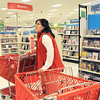 Sarem Sakeen, store manager, gathers stray items to be returned to shelves on the last day of the Broomfield Target store, Saturday.  Items not sold will be sent to other Target stores.<br /> January 26, 2012<br /> staff photo/ David R. Jennings