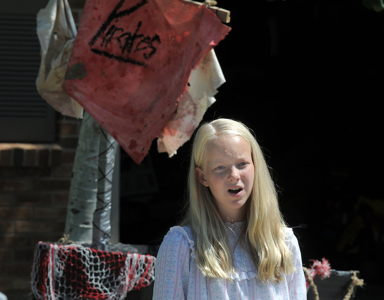 Katherine Knudtsen 11, playing Wendy, sings a solo during Saturday's dress rehearsal of the Lemonade Players neighborhood production of Peter Pan .<br /> <br /> <br /> June 25, 2011<br /> staff photo/ David R. Jennings