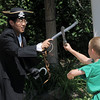 Peter Buchholtz, 13, playing Captain Hook, left, has  sword fight with James Knudtsen, 8, playing Peter Pan during Saturday's dress rehearsal of the Lemonade Players neighborhood production of Peter Pan.<br /> <br /> <br /> June 25, 2011<br /> staff photo/ David R. Jennings