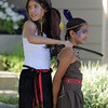 Katie Duffy, 10, left, playing Smee holds Jaelynn Martinez, 9, playing Tiger Lily during Sunday's performance of Peter Pan by the Lemonade Players.<br /> <br /> <br /> June 26, 2011<br /> staff photo/ David R. Jennings