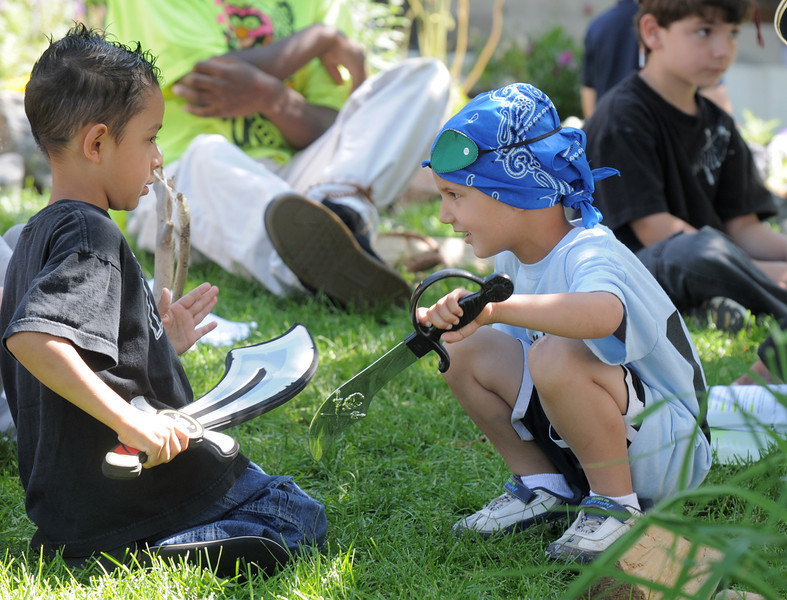 Tysson Martinez, 4, left, and Joe Lucas, 4, work on being pirates back stage during the dress rehearsal of the Lemonade Players production of Peter Pan on Saturday.<br /> <br /> <br /> June 25, 2011<br /> staff photo/ David R. Jennings