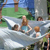 Diana Sabados, 13, left, and Ashlee Martinez, 12, create waves using  sheets to simulate the mermaids are in water during dress rehearsal of the Lemonade Players production of Peter Pan on Saturday.<br /> <br /> <br /> June 25, 2011<br /> staff photo/ David R. Jennings