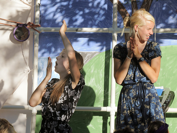 Directors Rebekah Sabados, 16, left, and Anna Grace Knudtsen, 17, signal the actors playing the indians to go onstage during Sunday's performance of Peter Pan by the Lemonade Players.<br /> <br /> <br /> June 26, 2011<br /> staff photo/ David R. Jennings