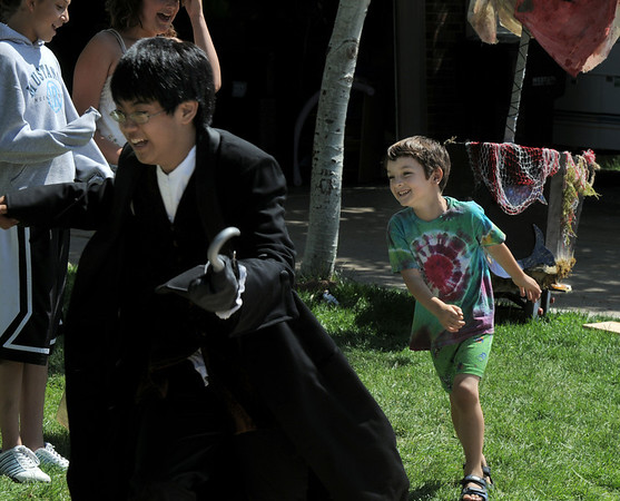 Donny Kennedy, 5, right, plays the crocodile chasing Peter Buchholtz, 13, playing Captain Hook during Saturday's dress rehearsal of the Lemonade Players neighborhood production of Peter Pan.<br /> <br /> June 25, 2011<br /> staff photo/ David R. Jennings