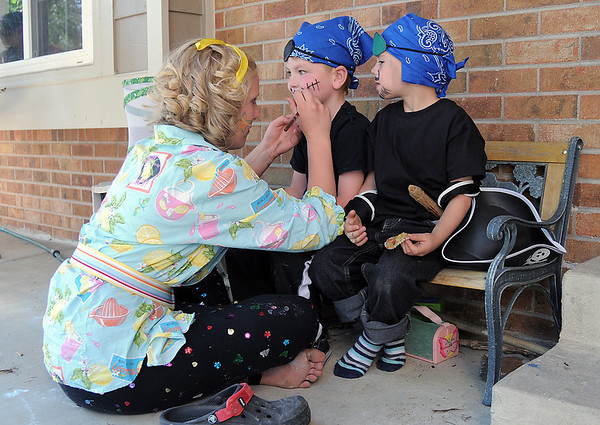 Diana Sabados, 13, left, puts makeup on pirates Brody Bricker, 4, and Josiah Horning, 5, before Sunday's performance of Peter Pan by the Lemonade Players.<br /> <br /> <br /> June 26, 2011<br /> staff photo/ David R. Jennings