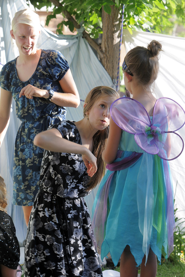 Rebekah Sabados, center, gives last minute instructions to Maycee Bricker, 7, playing Tinkerbell during the Lemonade Players performance of Peter Pan on Sunday.<br /> <br /> <br /> June 26, 2011<br /> staff photo/ David R. Jennings