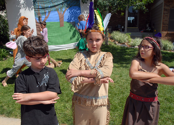 Indian Chief Adrianna Appelt, 9, center, sings with Caleb Jacksos, 6, left, and Jaelynn Martinez, 9, playing Tiger Lily during Saturday's dress rehearsal of the Lemonade Players neighborhood production of Peter Pan .<br /> <br /> <br /> June 25, 2011<br /> staff photo/ David R. Jennings