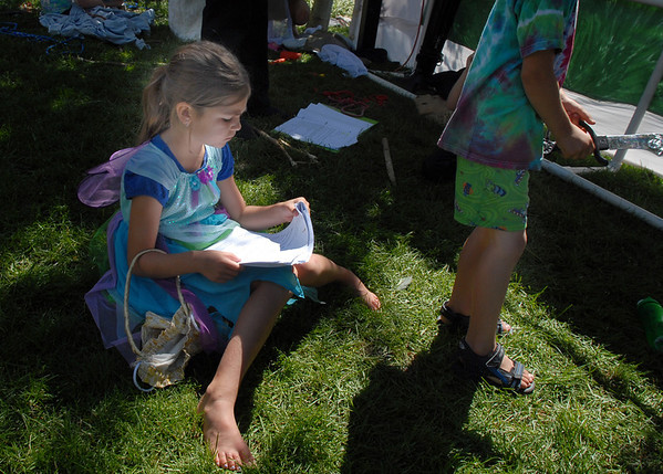 Tinkerbell played by  Maycee Bricker, 7, checks the scripts of the play backstage during Saturday's dress rehearsal of the Lemonade Players neighborhood production of Peter Pan .<br /> <br /> June 25, 2011<br /> staff photo/ David R. Jennings