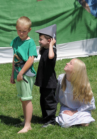 James Knudtsen, 8, left, playing Peter Pan, has his shadow, Josiah Horning, given back  by Katherine Knudtsen, 11, playing Wendy during Saturday's dress rehearsal of the Lemonade Players neighborhood production of Peter Pan.<br /> <br /> <br /> June 25, 2011<br /> staff photo/ David R. Jennings