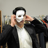 Schyler Vargus as the Phantom puts on his mask before the dress rehearsal of Legacy High School's presentation of The Phantom of the Opera  on Thursday.<br /> February 9, 2012<br /> staff photo/ David R. Jennings