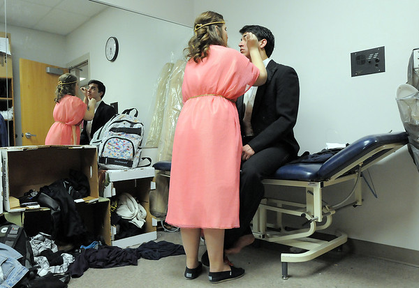 Christa Geshicki puts makeup on Schyler Vargus, playing the Phantom, before dress rehearsal of Legacy High School's presentation of The Phantom of the Opera  on Thursday.<br /> February 9, 2012<br /> staff photo/ David R. Jennings