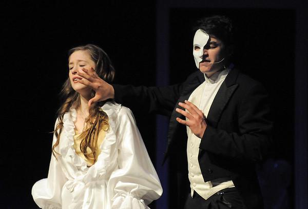 Audrey Felderman as Christine and Schyler Vargus as the Phantom sing together during dress rehearsal of Legacy High School's presentation of The Phantom of the Opera  on Thursday.<br /> February 9, 2012<br /> staff photo/ David R. Jennings