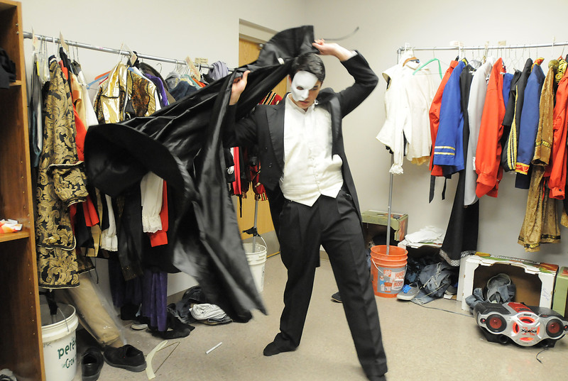 Schyler Vargus as the Phantom gets dressed before the dress rehearsal of Legacy High School's presentation of The Phantom of the Opera  on Thursday.<br /> February 9, 2012<br /> staff photo/ David R. Jennings