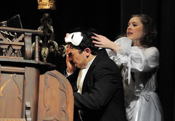 Audrey Felderman, Christine, takes the mask off of Schyler Vargus, the Phantom, during dress rehearsal of Legacy High School's presentation of The Phantom of the Opera  on Thursday.<br /> February 9, 2012<br /> staff photo/ David R. Jennings