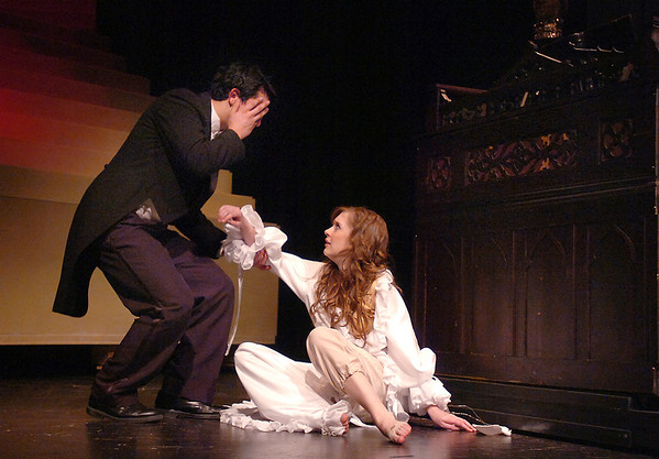 Schyler Vargus, the Phantom, reacts to Audrey Felderman, Christine, after the Phantom was unmasked by her during dress rehearsal of Legacy High School's presentation of The Phantom of the Opera  on Thursday.<br /> February 9, 2012<br /> staff photo/ David R. Jennings