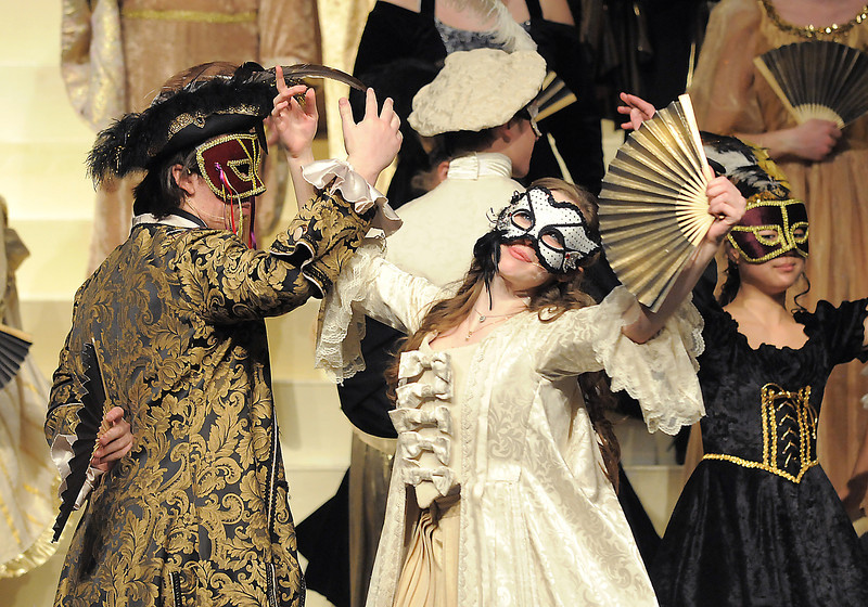 "Thomas Roller, Raoul, and Audrey Felderman, Christine, sing and dance to ""Masquerade"" at the ball during dress rehearsal of Legacy High School's presentation of The Phantom of the Opera  on Thursday.<br /> February 9, 2012<br /> staff photo/ David R. Jennings"