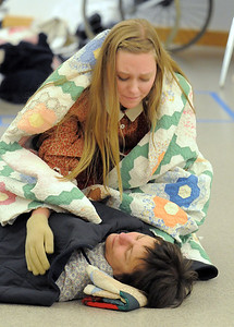 Madison Wagnaar  sings to her dying sister played by Nancey Bookstein during rehearsal for the Aster Women's Choir presentation of the Quilters. September 20, 2011 staff photo/ David R. Jennings
