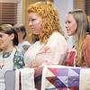 Corrie Ellington, left, Molly Crouse and Madison Wagnaar   stand behind quilts while waiting to go on stage during rehearsal for the Aster Women's Choir presentation of the Quilters.<br /> September 20, 2011<br /> staff photo/ David R. Jennings