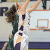 "Holy Family's Kassie Johannsen goes to the basket against  St. Mary's Emily Whitelaw during the 2011 Tiger Tip-off championship game at Holy Family on Saturday.<br /> More photos please see  <a href=""http://www.broomfieldenterprise.com"">http://www.broomfieldenterprise.com</a><br /> December 8, 2011<br /> Staff photo/ David R. Jennings"