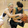 "Holy Family's Mckenzie Zeman fights for control of the ball with St. Mary's Kathleen Plamondon during the 2011 Tiger Tip-off championship game at Holy Family on Saturday.<br /> More photos please see  <a href=""http://www.broomfieldenterprise.com"">http://www.broomfieldenterprise.com</a><br /> December 8, 2011<br /> Staff photo/ David R. Jennings"