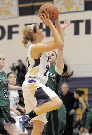"Holy Family's Stephanie Giltner does a lay-up past  St. Mary's Laura Broerman during the 2011 Tiger Tip-off championship game at Holy Family on Saturday.<br /> More photos please see  <a href=""http://www.broomfieldenterprise.com"">http://www.broomfieldenterprise.com</a><br /> December 8, 2011<br /> Staff photo/ David R. Jennings"