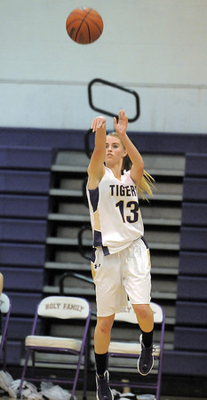 """Holy Family's Mckenzie Zeman shoots the ball against St. Mary's  during the 2011 Tiger Tip-off championship game at Holy Family on Saturday.<br /> More photos please see  <a href=""""http://www.broomfieldenterprise.com"""">http://www.broomfieldenterprise.com</a><br /> December 8, 2011<br /> Staff photo/ David R. Jennings"""