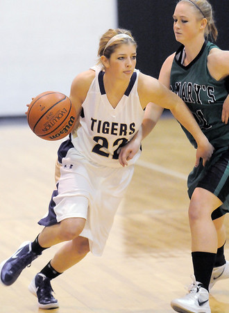 """Holy Family's Stephanie Giltner drives the ball against St. Mary's Dawn Reachard during the 2011 Tiger Tip-off championship game at Holy Family on Saturday.<br /> More photos please see  <a href=""""http://www.broomfieldenterprise.com"""">http://www.broomfieldenterprise.com</a><br /> December 8, 2011<br /> Staff photo/ David R. Jennings"""