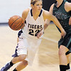 "Holy Family's Stephanie Giltner drives the ball against St. Mary's Dawn Reachard during the 2011 Tiger Tip-off championship game at Holy Family on Saturday.<br /> More photos please see  <a href=""http://www.broomfieldenterprise.com"">http://www.broomfieldenterprise.com</a><br /> December 8, 2011<br /> Staff photo/ David R. Jennings"