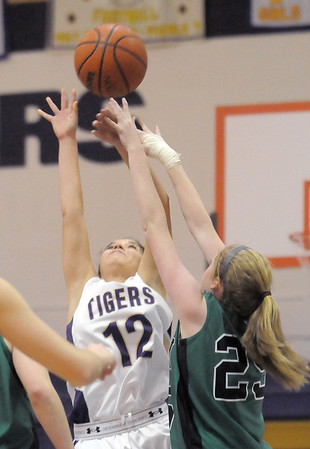 """Holy Family's Megan Chavez goes up for the ball against St. Mary's Nicole Niles during the 2011 Tiger Tip-off championship game at Holy Family on Saturday.<br /> More photos please see  <a href=""""http://www.broomfieldenterprise.com"""">http://www.broomfieldenterprise.com</a><br /> December 8, 2011<br /> Staff photo/ David R. Jennings"""