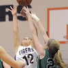 "Holy Family's Megan Chavez goes up for the ball against St. Mary's Nicole Niles during the 2011 Tiger Tip-off championship game at Holy Family on Saturday.<br /> More photos please see  <a href=""http://www.broomfieldenterprise.com"">http://www.broomfieldenterprise.com</a><br /> December 8, 2011<br /> Staff photo/ David R. Jennings"