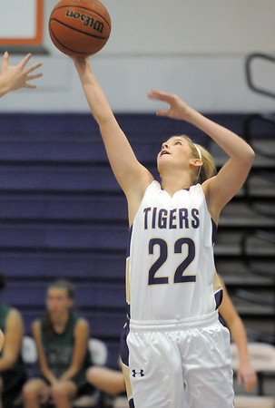 """Holy Family's Stephanie Giltner goes to the basket against St. Mary's during the 2011 Tiger Tip-off championship game at Holy Family on Saturday.<br /> More photos please see  <a href=""""http://www.broomfieldenterprise.com"""">http://www.broomfieldenterprise.com</a><br /> December 8, 2011<br /> Staff photo/ David R. Jennings"""