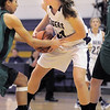 "Holy Family's Kassie Johannsen fights for control of the ball with St. Mary's Kathleen Plamondon during the 2011 Tiger Tip-off championship game at Holy Family on Saturday.<br /> More photos please see  <a href=""http://www.broomfieldenterprise.com"">http://www.broomfieldenterprise.com</a><br /> December 8, 2011<br /> Staff photo/ David R. Jennings"