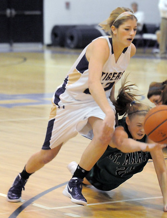 """Holy Family's Stephanie Giltner takes control of the ball from St. Mary's Dawn Reachard during the 2011 Tiger Tip-off championship game at Holy Family on Saturday.<br /> More photos please see  <a href=""""http://www.broomfieldenterprise.com"""">http://www.broomfieldenterprise.com</a><br /> December 8, 2011<br /> Staff photo/ David R. Jennings"""