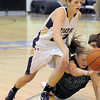 "Holy Family's Stephanie Giltner takes control of the ball from St. Mary's Dawn Reachard during the 2011 Tiger Tip-off championship game at Holy Family on Saturday.<br /> More photos please see  <a href=""http://www.broomfieldenterprise.com"">http://www.broomfieldenterprise.com</a><br /> December 8, 2011<br /> Staff photo/ David R. Jennings"