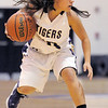 "Holy Family's Moriah Turney dribbles the ball downcourt against St. Mary's during the 2011 Tiger Tip-off championship game at Holy Family on Saturday.<br /> More photos please see  <a href=""http://www.broomfieldenterprise.com"">http://www.broomfieldenterprise.com</a><br /> December 8, 2011<br /> Staff photo/ David R. Jennings"